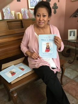 Irma showing off her first book Mitzie